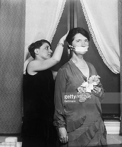 Birth control advocate Margaret Sanger has her mouth covered in protest of not being allowed to talk about birth control in Boston