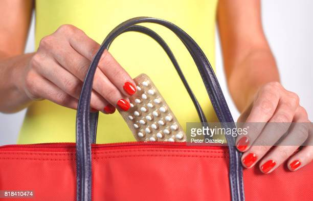 birth control pills in handbag - evening bag stock pictures, royalty-free photos & images