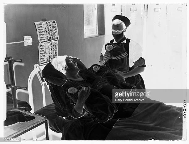 Birth of triplets 1939 A photograph of a woman and nurse with newlyborn triplets taken by Roper for the Daily Herald newspaper on 13 August 1939 The...