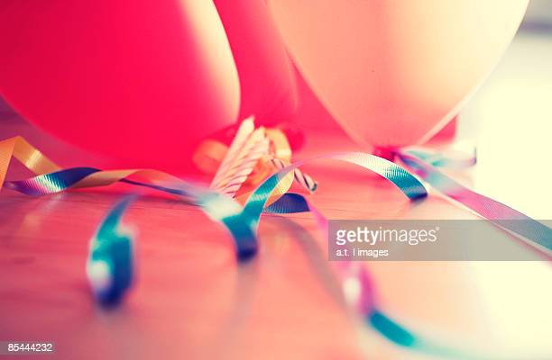 birthday ballons, candles, and streamers - birthday balloons stock photos and pictures