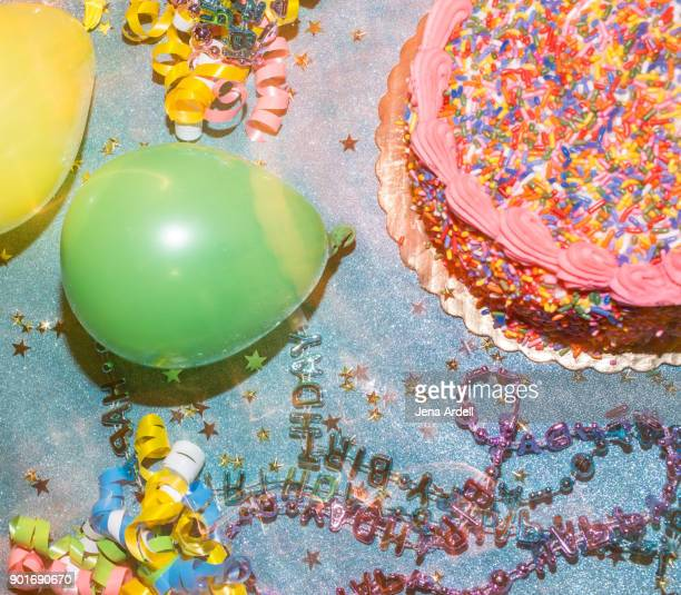 birthday cake and birthday party decorations - happy birthday stock pictures, royalty-free photos & images