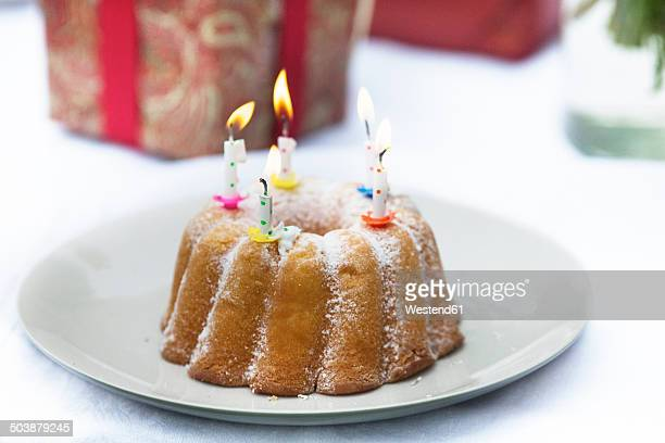 Birthday cake and gift on outdoor table