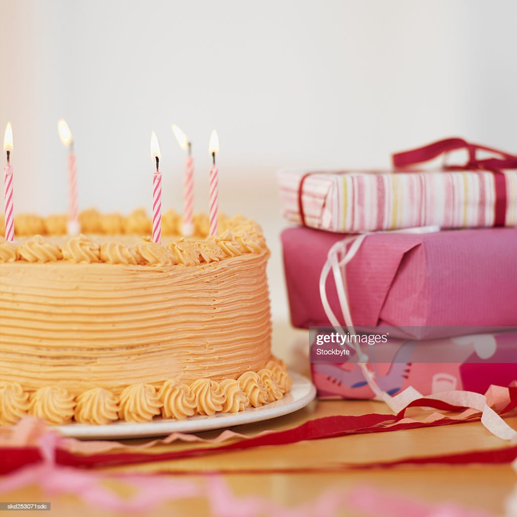 Birthday Cake And Presents On A Table Stock Photo