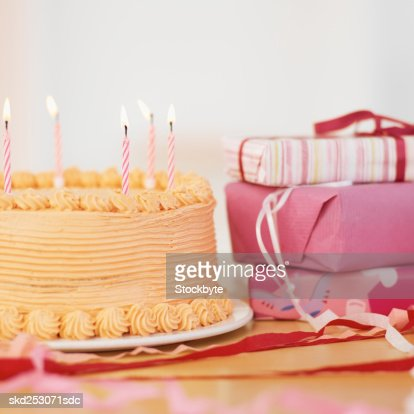 Birthday Cake And Presents On A Table Stock Foto