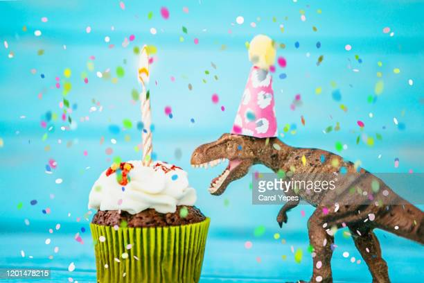 birthday cake and  toy dinosaur - cartoon desserts stock pictures, royalty-free photos & images