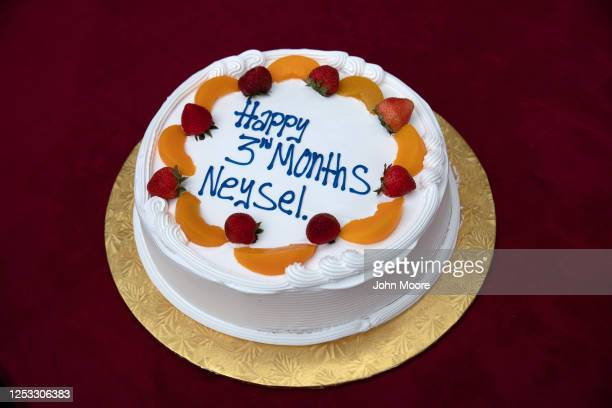 A birthday cake awaits guests at a dinner celebrating baby Neysel's three month birthday on June 28 2020 in Stamford Connecticut The Guatemalan...