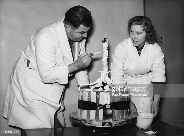 A birthday cake being prepared for the 79th Birthday of British Prime Minister Winston Churchill 30th November 1953 The cake is ringed by icing sugar...