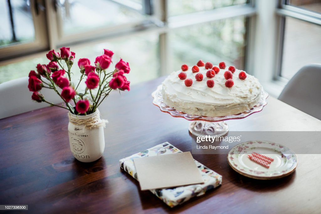 Birthday Cake Present And Greeting Card On A Table Stock Photo