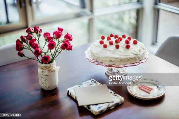 birthday cake, birthday present and greeting card on a table - happy birthday canada stock pictures, royalty-free photos & images