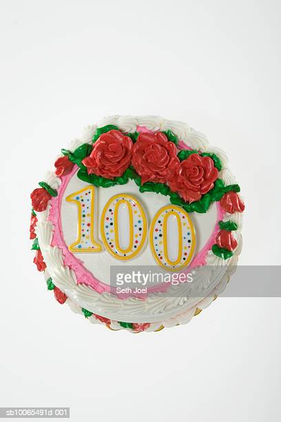 Birthday cake decorated with roses and number 100, white background