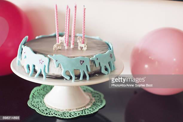 Birthday cake decorated with unicorns