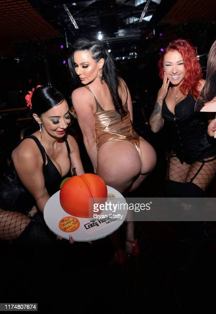 A birthday cake is presented to adult film actress Kendra Lust during her birthday celebration at the Crazy Horse 3 Gentlemen's Club on September 14...