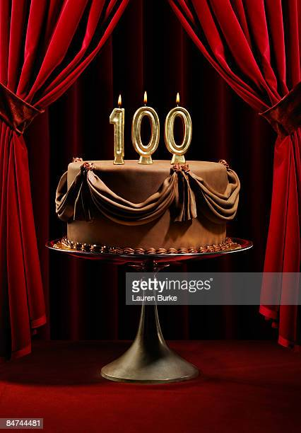 Birthday cake on stage with 100 candles