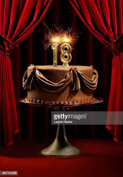 Birthday Cake on Stage with Number 18 Candles