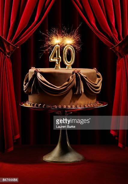 birthday cake on stage with number 40 candles - number 40 stock photos and pictures