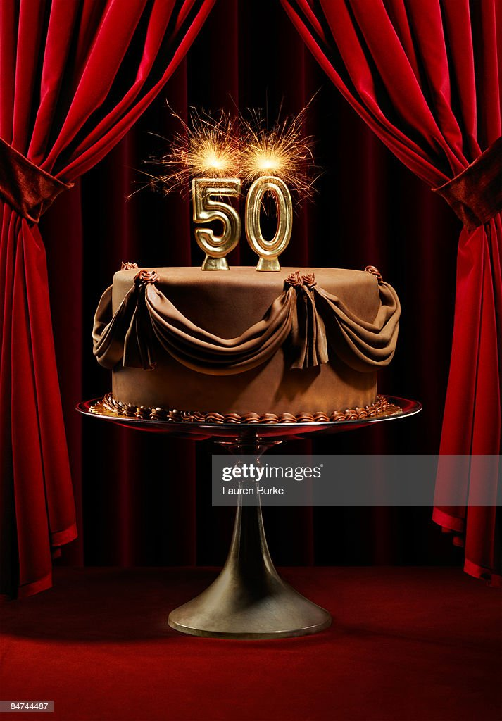 BIrthday Cake On Stage With Number 50 Candles Stock Photo