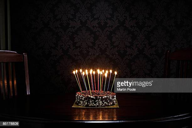 birthday cake on table in living room - birthday cake stock pictures, royalty-free photos & images