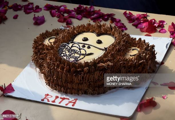 A birthday cake to celebrate the birthday of chimpanzee Rita is seen at a zoo in New Delhi on December 14 2017 / AFP PHOTO / MONEY SHARMA