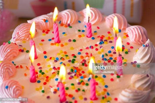 birthday cake with burning candles, close-up - birthday cake lots of candles stock photos and pictures