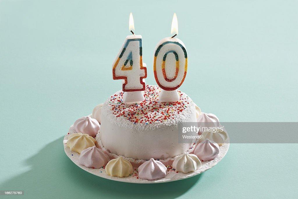 Birthday cake with burning candles : Stock Photo