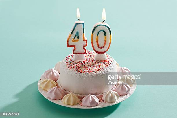 birthday cake with burning candles - number 40 stock photos and pictures