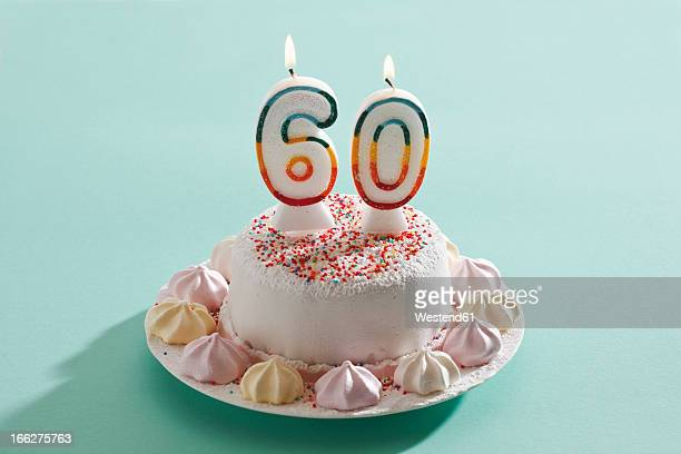 birthday cake with burning candles - number 60 stock photos and pictures
