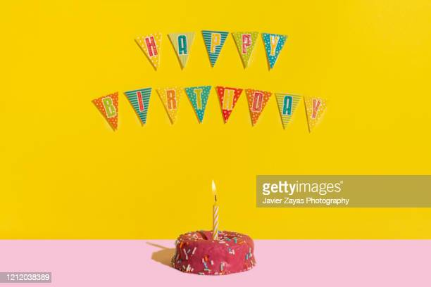 birthday cake with candle and colorful decoration during birthday party - birthday cake stock pictures, royalty-free photos & images