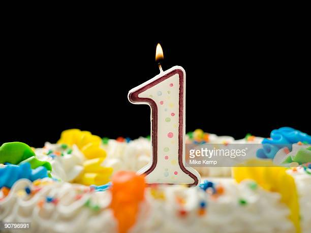birthday cake with candle that says 1 - first birthday imagens e fotografias de stock