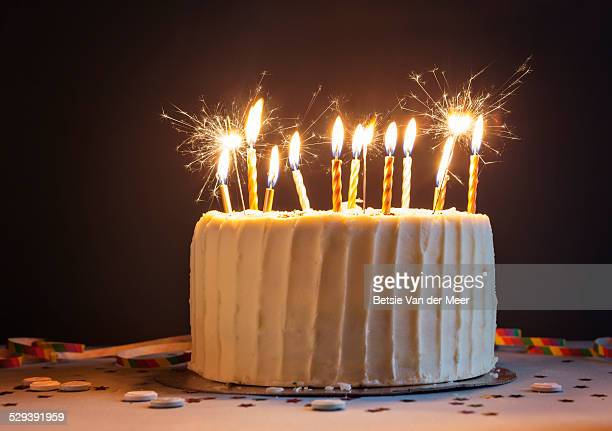 birthday cake with candles and sparklers. - birthday cake stock photos and pictures