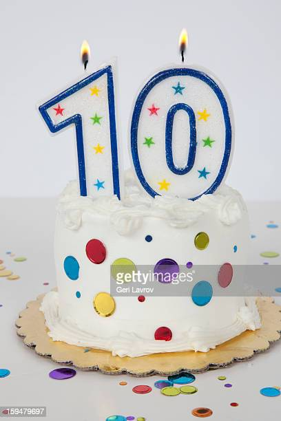 Birthday cake with candles lit (10 years)