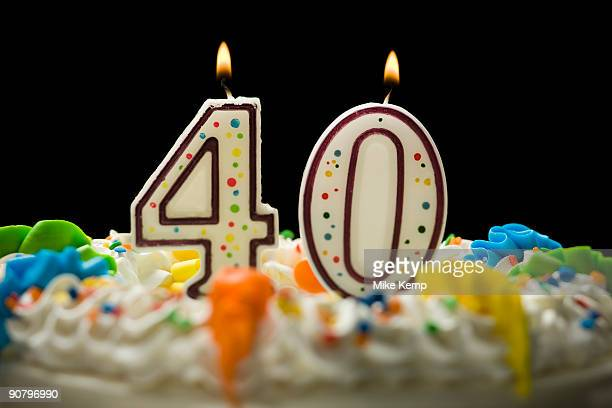 birthday cake with candles that say 40 - number 40 stock photos and pictures
