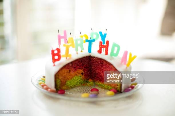 birthday cake with colorful candles - birthday cake stock photos and pictures
