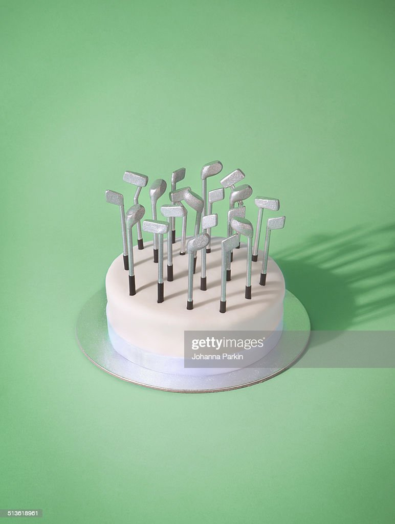 Groovy Birthday Cake With Golf Club Candles High Res Stock Photo Getty Funny Birthday Cards Online Eattedamsfinfo
