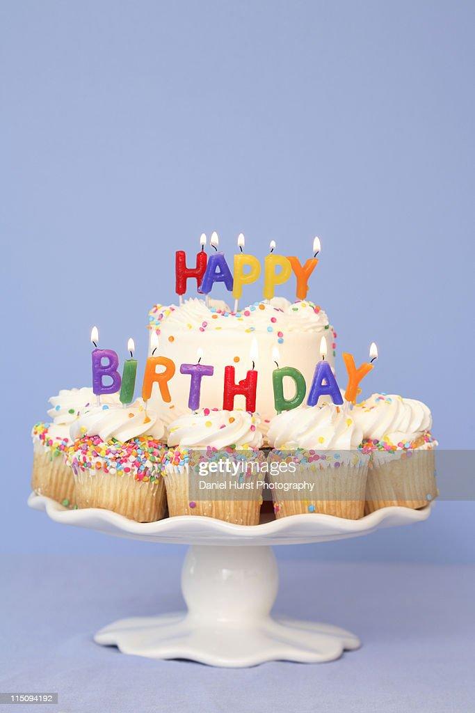 Birthday Cake With Happy Candles Stock Photo