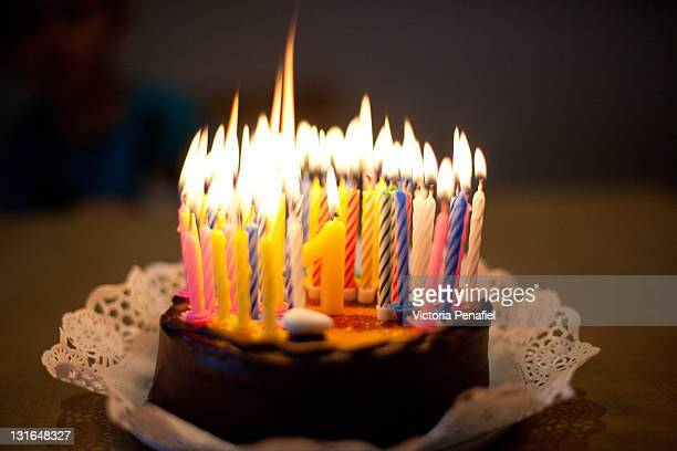birthday cake with lit candles - birthday cake lots of candles stock photos and pictures