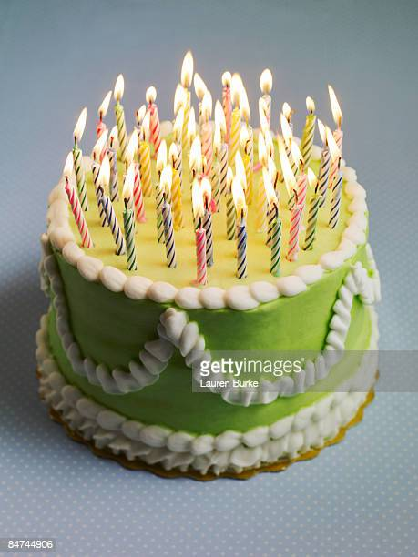 birthday cake with many candles - birthday cake stock photos and pictures