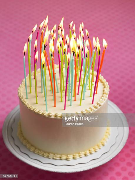 birthday cake with many candles - birthday cake stock pictures, royalty-free photos & images