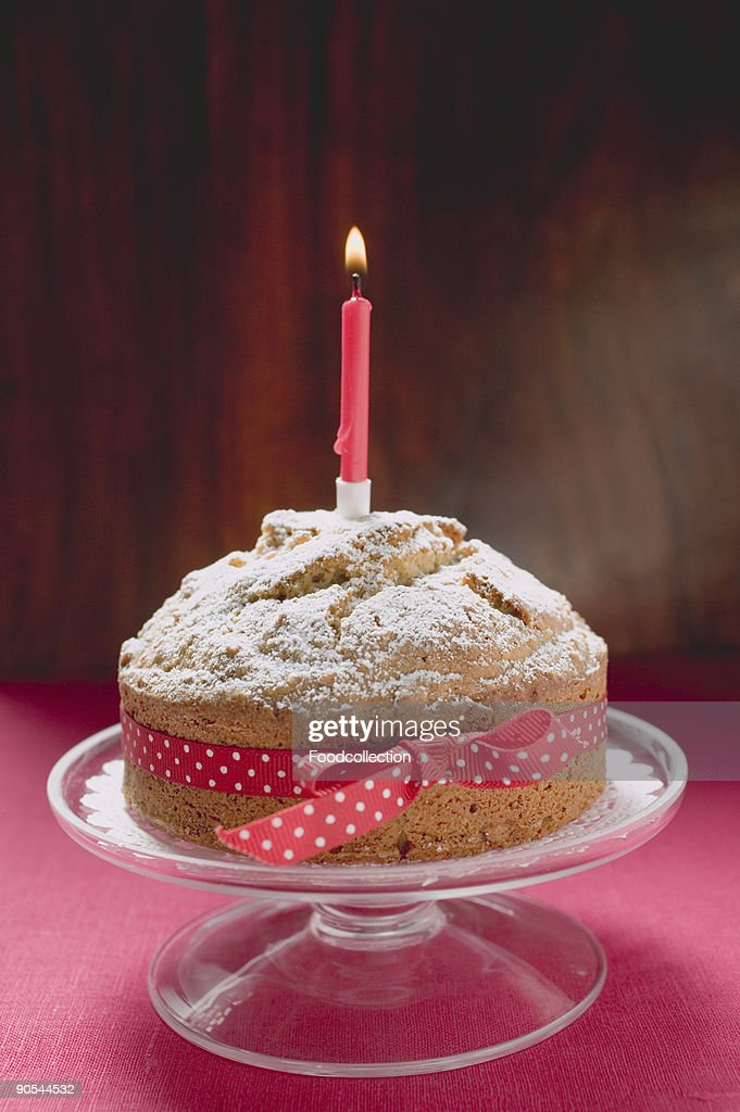 Groovy Birthday Cake With Red Bow And Candle High Res Stock Photo Getty Personalised Birthday Cards Epsylily Jamesorg