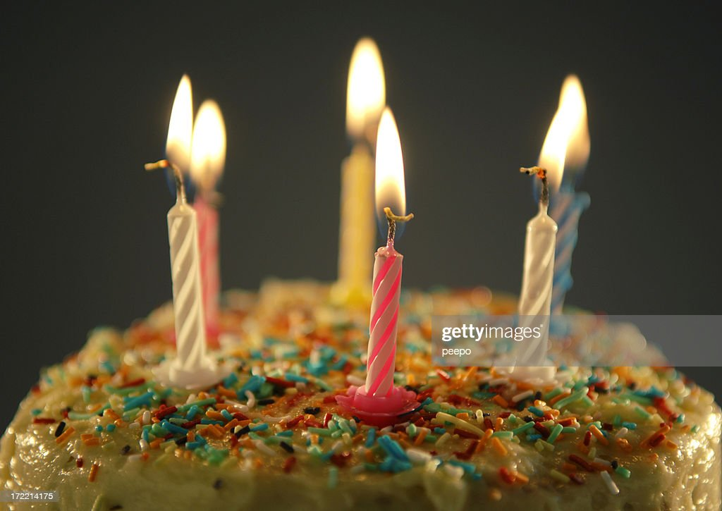 Birthday Cake With Sprinkles And Six Lit Candles Stock Photo