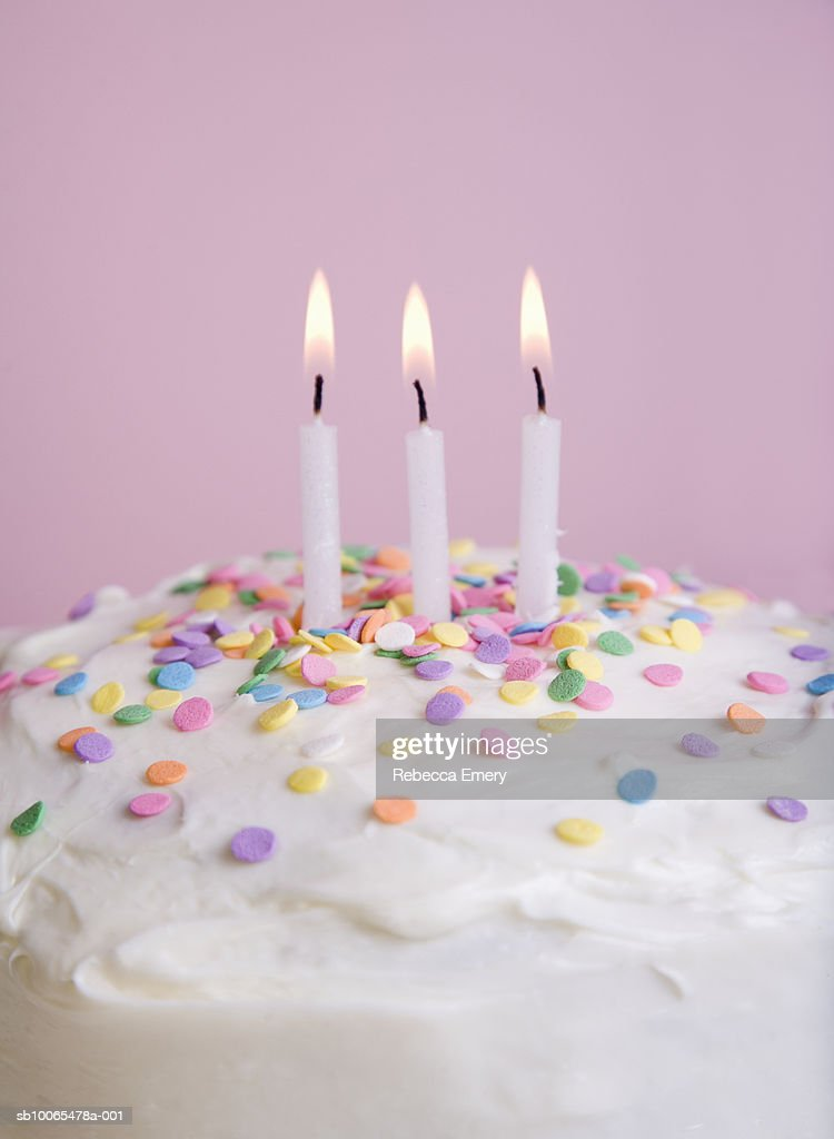 Birthday Cake With Sprinkles And Three Lit Candles Closeup Stock
