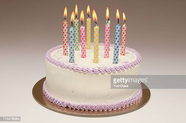 birthday cake with ten colourful candles - birthday cake stock pictures, royalty-free photos & images