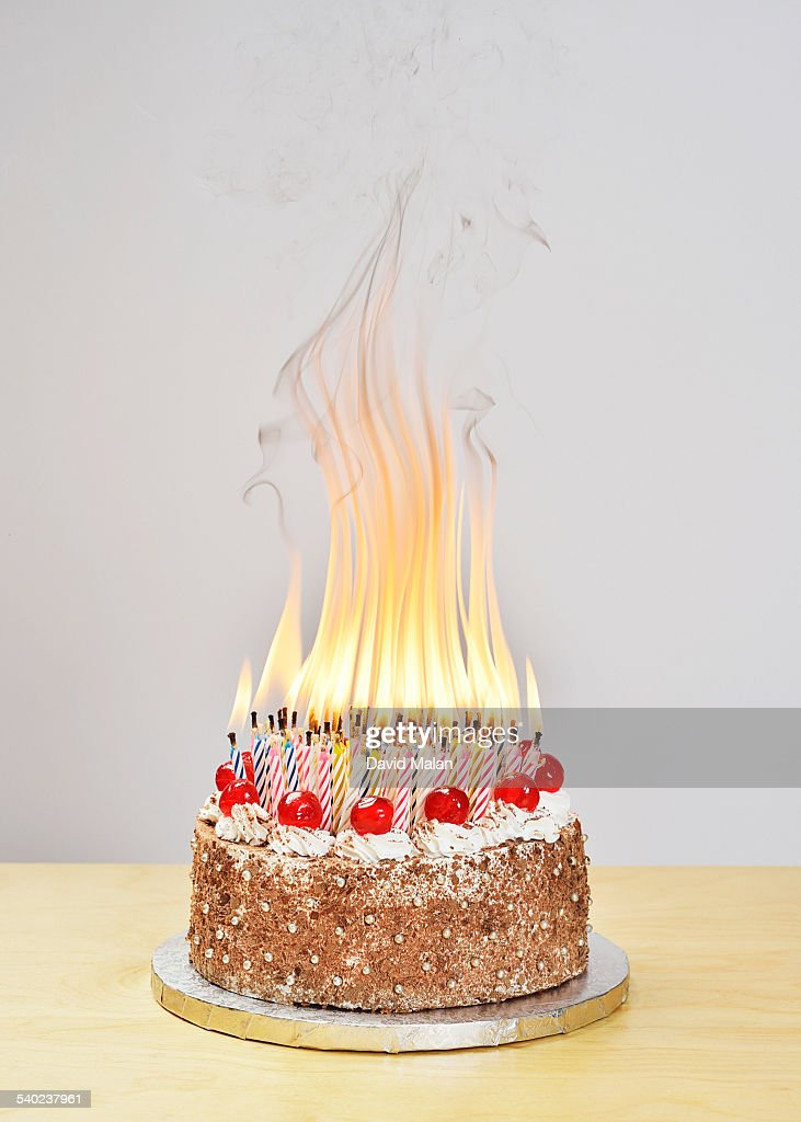 100 Birthday Candles Burning On A Cake Stock Photo