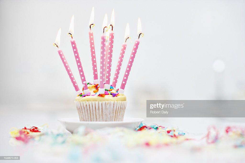 Birthday candles on cupcake : Stock Photo