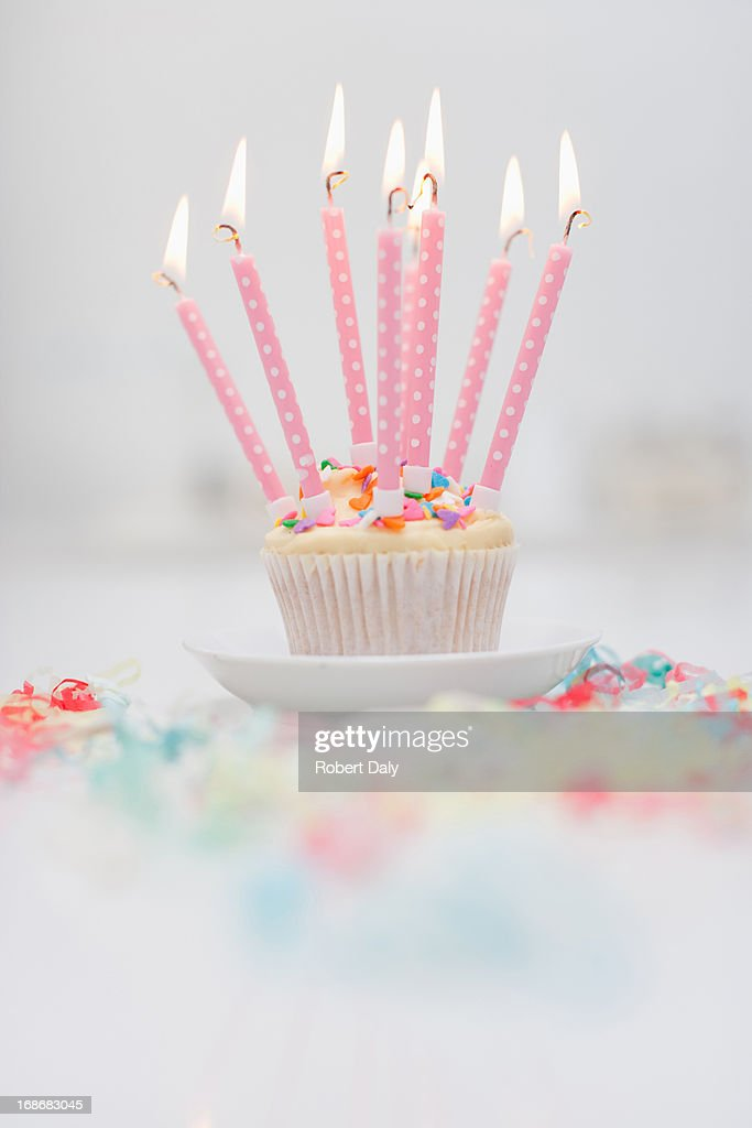 Birthday candles on cupcake : Bildbanksbilder