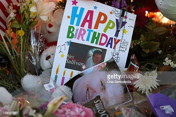A birthday card for Alex Sullivan one of the 12 vicitims of last weekend's mass shooting at the Century 16 movie theater is left at a makeshift...