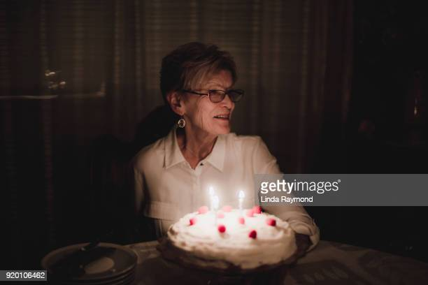 birthday celebration of an elderly woman - happy birthday canada stock pictures, royalty-free photos & images