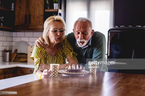 birthday celebration of senior couple - serbia stock pictures, royalty-free photos & images