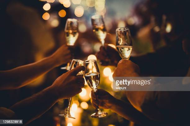 birthday celebratory toast with string lights and champagne silhouettes - political party stock pictures, royalty-free photos & images