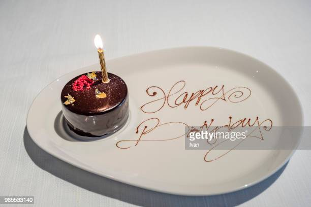 birthday chocolate cake with candles - cakestand stock pictures, royalty-free photos & images