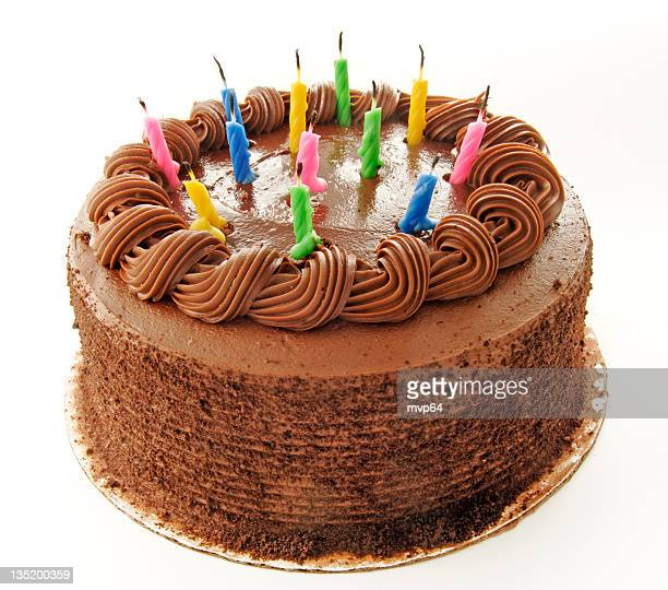 birthday chocolate cake with colorful candles - birthday cake stock photos and pictures